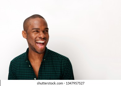Close up portrait of happy young african american guy laughing against isolated white background
