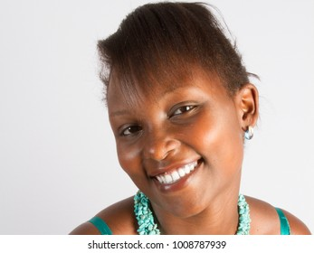 Close up portrait of a happy young black woman smiling girl