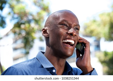 Close up portrait of laughing african american businessman talking on cellphone