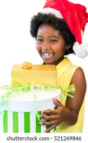 Close up portrait of laughing african girl holding christmas presents.Child wearing red hat isolated on white background.