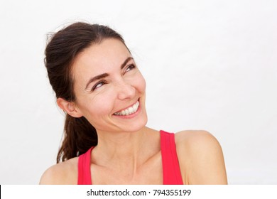 Close up portrait of laughing sports woman looking away at copy space
