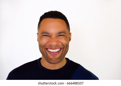 Close up portrait of laughing young african man against white background