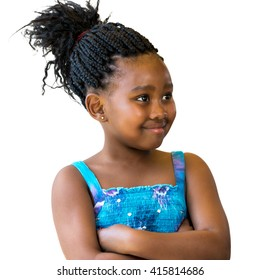 Close up portrait of little african girl with braided hair looking aside.Isolated against white background.