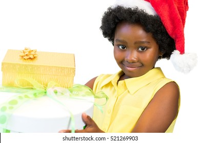 Close up portrait of little african girl holding christmas gifts.Child wearing red hat isolated on white background.