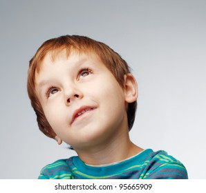 Close up portrait of a little boy looking away.