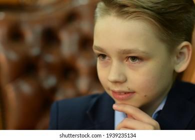 Close up portrait of little boy posing