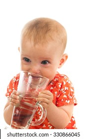 close up Portrait of a little cute baby girl drinking water, isolated on white background