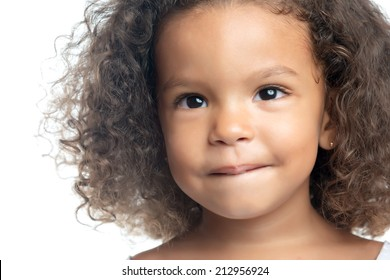 Close up portrait of a little girl with an afro hairstyle