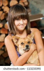 Close up portrait of little girl and her dog.