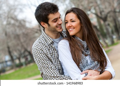 Close up portrait of in love couple outdoors.