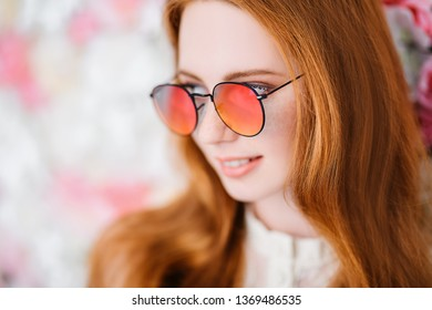 A close up portrait of a lovely beautiful girl in sunglasses. Beauty, cosmetics, optics.