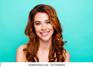 Close up portrait of lovely, cute, sweet, gorgeous, nice, stunning, adorable, good-looking woman with big toothy smile, curly ginger hairstyle look in camera isolated on bright teal background