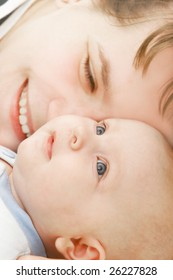 close up portrait of loving mother and baby