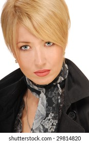 close up portrait of a luxurious blond woman with beautiful blue eyes,dressed in a black coat, isolated on on white background