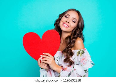 Close up portrait of magnificent, exquisite, delicate, winsome, lovable, fascinating lady look at camera hold big paper card in hands isolated on vivid turquoise background