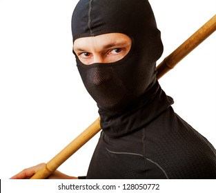 Close up portrait of male ninja in black mask covered his face