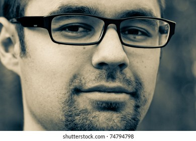Close up portrait of man with glasses