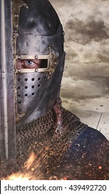 Close up portrait of a man in knight helmet.