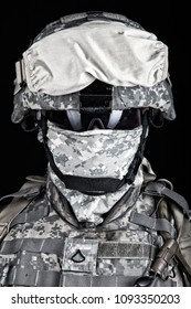 Close up portrait of marine raider, elite army squad member, military company mercenary in combat helmet, pixel camo uniform, protected with balaclava and glasses face studio shot on black background