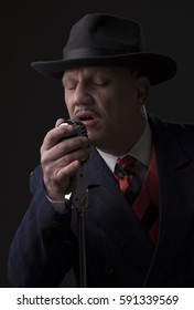 Close up portrait of a mature Jazz man singing into a microphone
