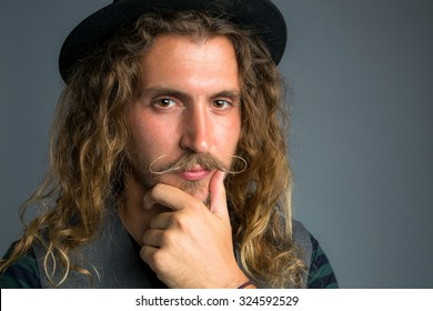 Close up portrait of millennial hipster modern youth young adult facial hair serious look