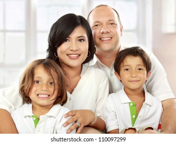 close up portrait of mixed race family in the living room