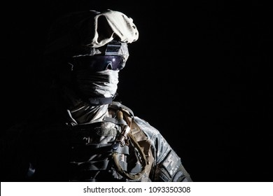 Close up portrait of modern infantry soldier, active army fighter, military mercenary in helmet, face hidden with balaclava and glasses high contrast, cropped on black background. Hybrid war concept