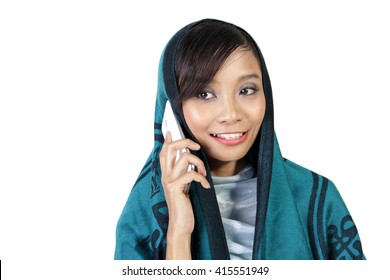 Close up portrait of a muslim woman talking on her cellphone, isolated on white background