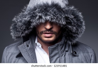 close up portrait of mysterious man on grey background