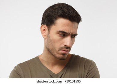 Close up portrait of offended young man, looking down, feeling guilty of relationship problems, stressed by weak potency