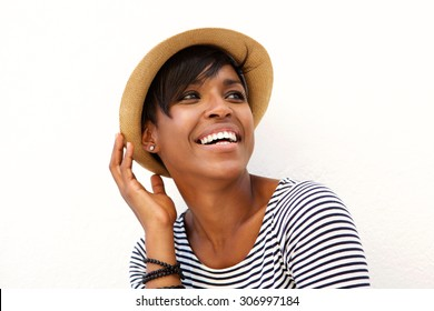 Close up portrait of one black woman smiling with hat against white background