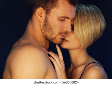 Close up portrait pf romantic couple in love in erotic pose. Emotive of sexy couple.