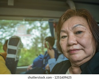 Close up portrait Photo of Senior asian women in the bus at changsha city china.asian older travel by bus.