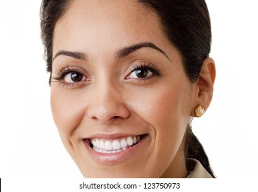 Close up portrait of a professional Hispanic business woman wearing a tan suit looking at camera isolated on white
