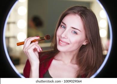 Close up portrait of a professional make up artist. Ring light for make up artists round LED