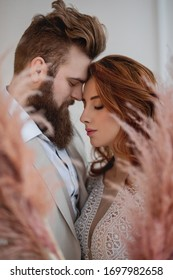 close portrait of a red-haired girl and a bearded guy