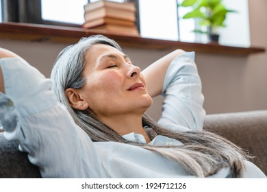 Close up portrait of a relaxing middle-aged woman having a break on the sofa