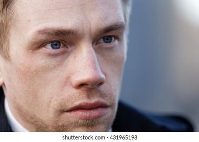 Close up portrait of romantic charismatic blonde man