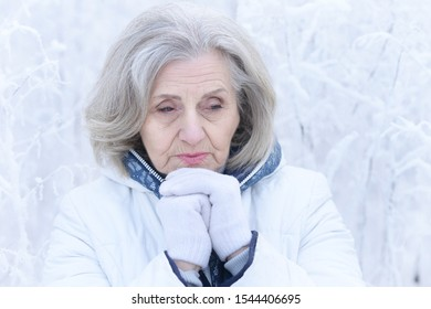 Close up portrait of sad beautiful senior woman