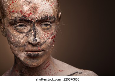 close up portrait of sad  beauty woman with face art