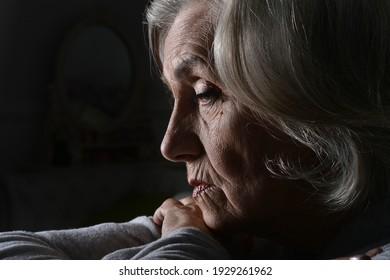 Close up portrait of sad senior woman posing isolated