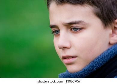Close up portrait of a sad teenager