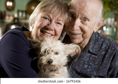 Close Up Portrait of Senior Couple with Dog
