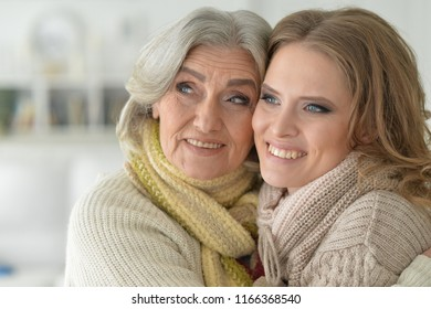 Close up portrait of senior woman with daughter