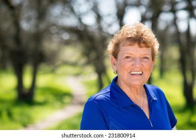 Close up portrait of senior woman enjoying nature