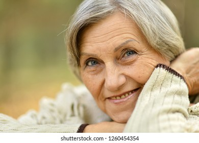 Close up portrait of a senior woman on nature