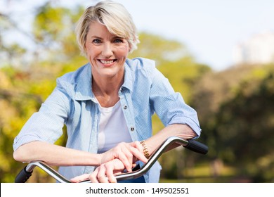 close up portrait of senior woman on a bicycle