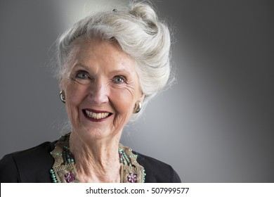 Close up portrait of a senior woman, smiling, looking at the camera