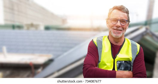 Close up portrait of senior worker wearing reflective clothing against workshop