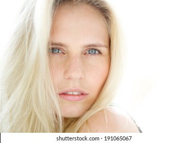 Close up portrait of a sensual young blond woman with blue eyes